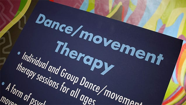 Image of sign at 11th Street Health Center with words Dance Movement Therapy